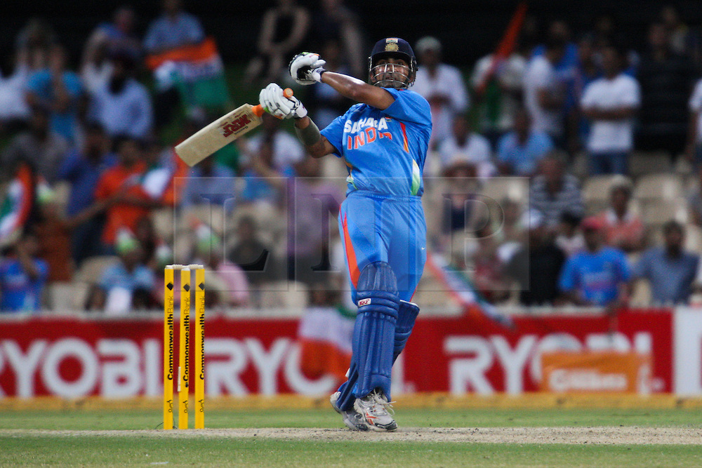 © Licensed to London News Pictures. 14/02/2012. Adelaide Oval, Australia. Gautam Gambhir plays a pull shot one handed during the One Day International cricket match between India Vs Sri Lanka. Photo credit : Asanka Brendon Ratnayake/LNP