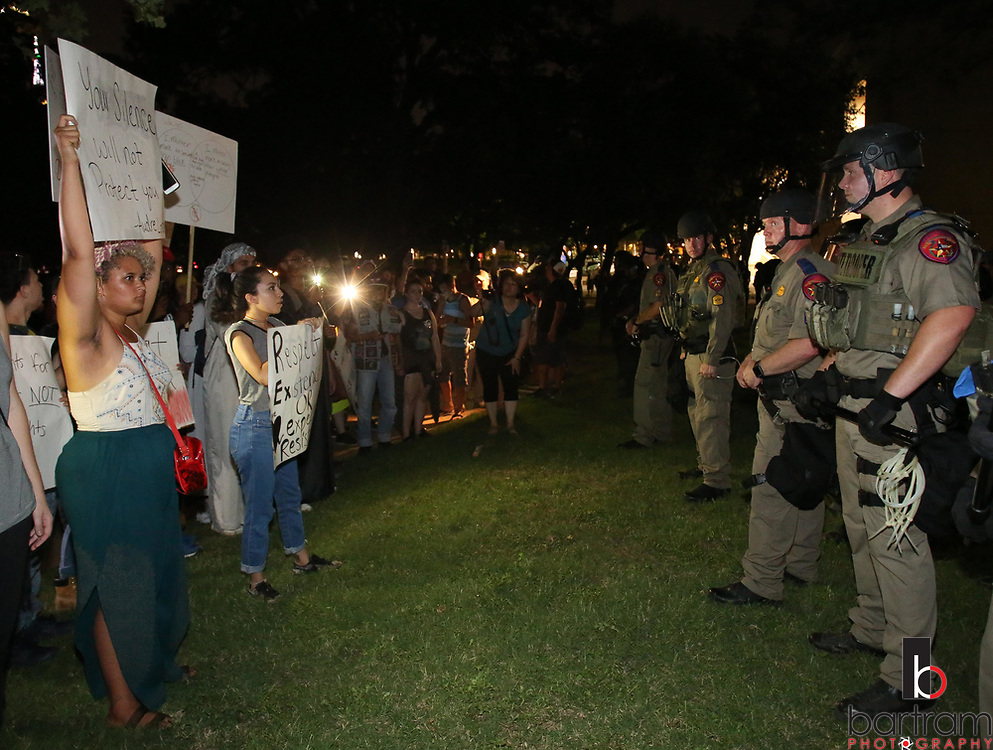 Protestors face off against police in Pioneer Park Cemetery following an anti white-supremacy rally at Dallas City Hall plaza on Saturday, Aug. 19, 2017. (Photo by Kevin Bartram)