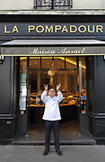 Dominique Anract, baker, throwing a loaf of bread in the air outside his bakery La Pompadour, on the Rue de la Tour in the 16th arrondissement of Paris, France. Dominique Anract comes from a family of bakers and this is his third bakery, where he employs 30 people and 8 apprentices, housed in a building built in 1868 under Napoleon III. He is also president of the Confederation Nationale de la Boulangerie-Patisserie Francaise, or National Confederation of French Bakery, tasked to protect the quality and integrity of French bakery and patisserie. Photographed on 16th January 2019 by Manuel Cohen