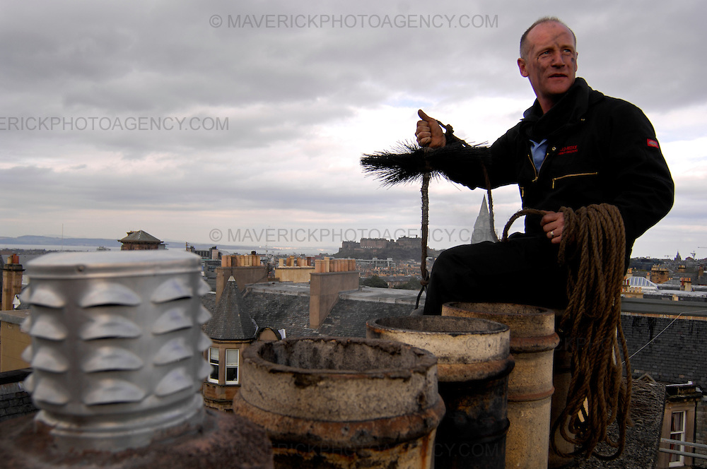Feature on Chimney Sweeps. Pictured Kirk McLenaghan from Auld Reekie chimney sweeps cleaning chimneys on the roof of a block of flats in Viewforth Edinburgh.