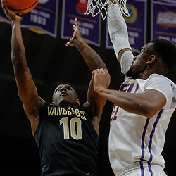 Feb 20, 2018; Baton Rouge, LA, USA; Vanderbilt Commodores guard Maxwell Evans (10) shoots over LSU Tigers forward Aaron Epps (21) during the first half at the Pete Maravich Assembly Center. Mandatory Credit: Derick E. Hingle-USA TODAY Sports