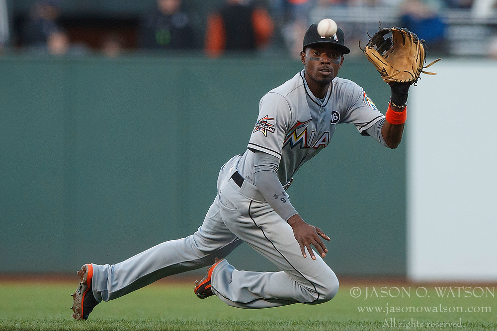 SAN FRANCISCO, CA - JULY 07: Dee Gordon #9 of the Miami Marlins fields a ground ball hit off that bat of Denard Span (not pictured) of the San Francisco Giants during the first inning at AT&T Park on July 7, 2017 in San Francisco, California. The Miami Marlins defeated the San Francisco Giants 6-1. (Photo by Jason O. Watson/Getty Images) *** Local Caption *** Dee Gordon