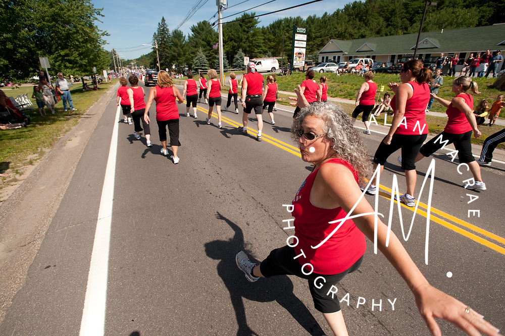 Members of Jazzercise entertain the crowd as they work out along the parade route in Ashland's annual 4th of July Parade Saturday.  (Alan MacRae/for the Citizen)