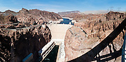 Hoover Dam, once known as Boulder Dam, is a concrete arch-gravity dam in the Black Canyon of the Colorado River, on the border between Arizona and Nevada, USA. Hoover Dam was built between 1931 and 1936 during the Great Depression, about 25 miles (40 km) southeast of Las Vegas. The dam impounds Lake Mead, the largest man-made reservoir in the United States. (Panorama stitched from 8 photos.)