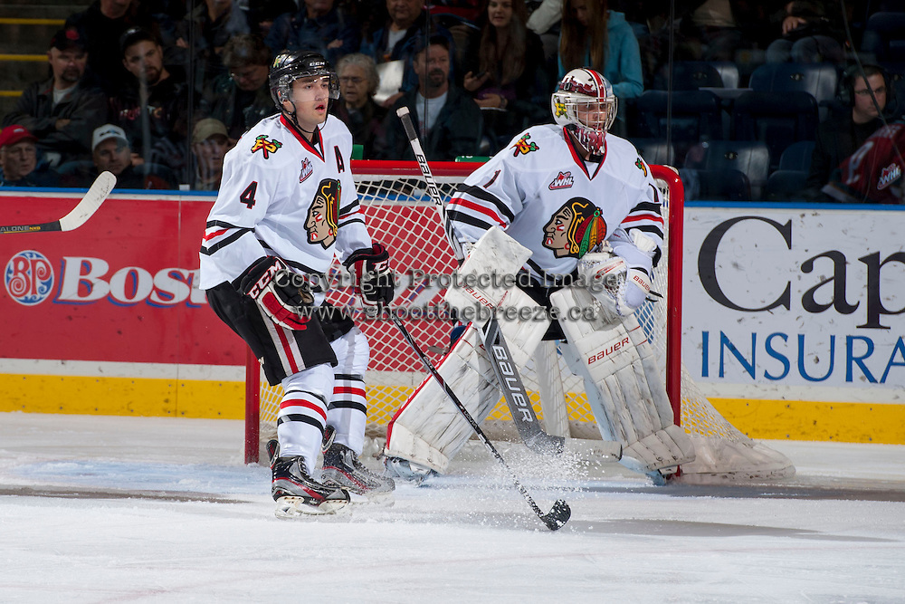 KELOWNA, CANADA - OCTOBER 4:   Josh Hanson #4 of the Portland Winterhawks stands in front of the net of Brendan Burke #1 of the Portland Winterhawks at the Kelowna Rockets on October 4, 2013 at Prospera Place in Kelowna, British Columbia, Canada (Photo by Marissa Baecker/Shoot the Breeze) *** Local Caption ***