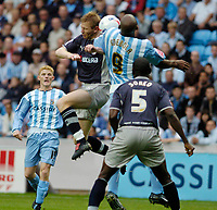 Photo: Leigh Quinnell.<br /> Coventry v Reading. Coca Cola Championship.<br /> 10/09/2005. Coventrys Dele Adebola jumps with Readings Brynjar Gunnarsson.