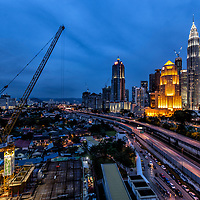 A contrasty view of the underdeveloped Kampung Baru (L) against the skyline of metropolitan Kuala Lumpur city at dusk in Kampung Baru, Kuala Lumpur, Malaysia, 10 April 2017.