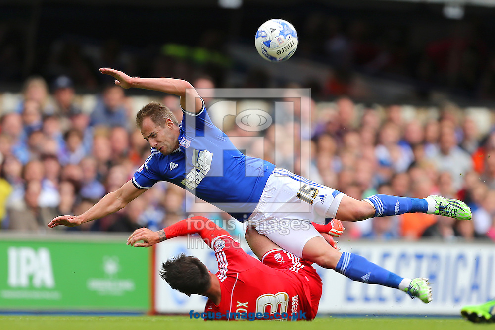 Luke Varney of Ipswich Town is challenged by Danny Fox of Nottingham Forest during the Sky Bet Championship match at Portman Road, Ipswich<br /> Picture by Richard Calver/Focus Images Ltd +44 7792 981244<br /> 25/04/2015