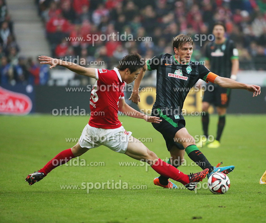 01.11.2014, Coface Arena, Mainz, GER, 1. FBL, 1. FSV Mainz 05 vs SV Werder Bremen, 10. Runde, im Bild v.l.: Ja-Cheol Koo (Mainz) gegen Clemens Fritz (Bremen) // during the German Bundesliga 10th round match between 1. FSV Mainz 05 and SV Werder Bremen at the Coface Arena in Mainz, Germany on 2014/11/01. EXPA Pictures &copy; 2014, PhotoCredit: EXPA/ Eibner-Pressefoto/ Neurohr<br /> <br /> *****ATTENTION - OUT of GER*****