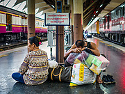 11 APRIL 2018 - BANGKOK, THAILAND:  A man rests with his luggage while he waits for a train at Hua Lamphong train station in Bangkok on the first day of the Songkran travel period. Songkran is the traditional Thai New Year and is one of the busiest travel periods of the year as Thais leave the capital and go back to their home provinces or resorts in tourist areas. Trains and busses are typically jammed the day before the three day Songkran holiday starts. The government has extended the official holiday period through Monday, 16 April because one day of the Songkran holiday fell on the weekend, giving many workers a five day holiday.     PHOTO BY JACK KURTZ