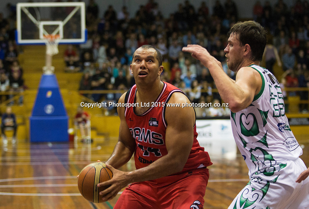 Marques Whippy of the Rams goes hard to the basket with Jeremiah Trueman of the Jets in defence during the National Basketball League game between the Canterbury Rams v Manawatu Jets at Cowles Stadium in Christchurch. 10th April 2015 Photo: Joseph Johnson/www.photosport.co.nz