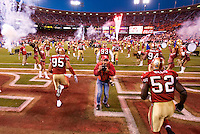 15 December 2007: The San Francisco 49ers run onto the field past photographer Michael Zagaris during player introductions before the 49ers 20-13 victory over the Cincinnati Bengals at Monster Park in San Francisco.