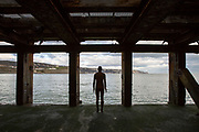 An Antony Gormley cast iron figure from the series 'Another Time' located on the half tide loading bay of the Folkestone Harbour Arm. Part of the 2017 Folkestone Triennial. Folkestone, Kent. (photo by Andrew Aitchison / In pictures via Getty Images)