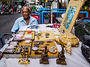 22 DECEMBER 2018 - CHANTABURI, THAILAND: A Thai man selling precious stones and Buddhist amulets in the gem market in Chantaburi. The gem market in Chantaburi, a provincial town in eastern Thailand, is open on weekends. Chantaburi used to be an active gem mining area in Thailand, but the mines are played out now. Now buyers and sellers come from around the world to Chantaburi for the weekend market. Many of the stones come from Myanmar, others come from mines in Afghanistan and Africa.       PHOTO BY JACK KURTZ
