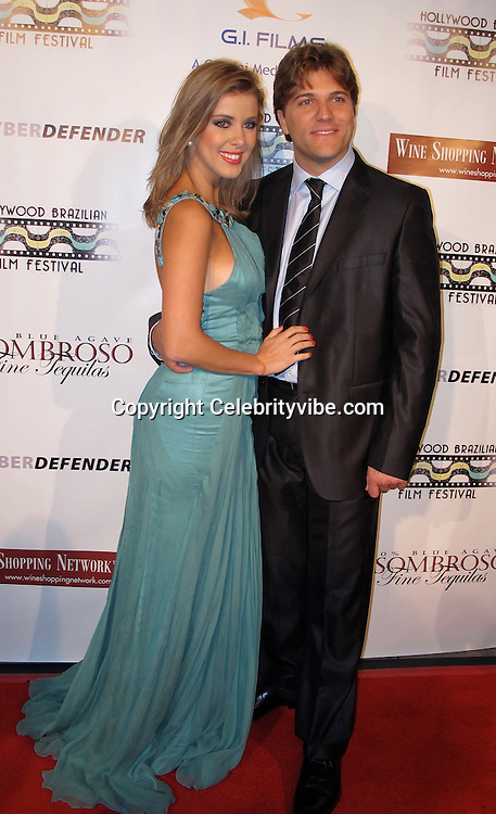 Director Roberto Carminati with his wife Actress and Model Marcela Tinti..Brazilian Film Festival Opening Gala..Screening of Seguraca Nacional Movie..American Cinematheque Egyptian Theatre..Hollywood, CA, USA..Thursday, February 04, 2010..Photo By Celebrityvibe.com.To license this image please call (212) 410 5354; or Email: celebrityvibe@gmail.com ; .website: www.celebrityvibe.com.