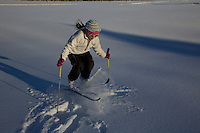 Jessica Laman (age 9)  cross-country skiing below the Teton Range, does some jumps on her skis.<br />