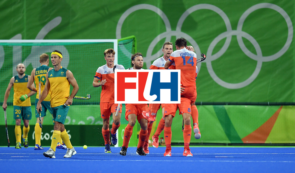 Netherland's Billy Bakker (R) celebrates with teammates their second goal during the men's quarterfinal field hockey Netherlands vs Australia match of the Rio 2016 Olympics Games at the Olympic Hockey Centre in Rio de Janeiro on August 14, 2016. / AFP / MANAN VATSYAYANA        (Photo credit should read MANAN VATSYAYANA/AFP/Getty Images)