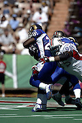 Miami Dolphins defensive tackle Tim Bowens (95) tackles St. Louis Rams running back Marshall Faulk in the 2003 Pro Bowl, the NFL All-Star Game at Aloha Stadium on 02/02/2003. The AFC intercepted 6 passes to beat the NFC (45 to 20) for the 3rd straight year. ©Paul Anthony Spinelli