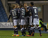 Picture by David Horn/Focus Images Ltd +44 7545 970036<br /> 03/12/2013<br /> Steve Morison of Millwall (2nd left) celebrates with team mates after scoring his first goal of the game to make it 1-0 during the Sky Bet Championship match at The Den, London.