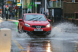 © Licensed to London News Pictures. 20/12/12/019. London, UK. A car travels through a flood on Green Lanes, Harringay in North London, caused by overnight heavy rainfall and a pipe burst.  Photo credit: Dinendra Haria/LNP