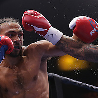 Keith Thurman (L) and Luis Collazo exchange punches during their Premier Boxing Champions boxing match for the WBA Welterweight title on ESPN at the USF Sun Dome, on Saturday, July 11, 2015 in Tampa, Florida.  Thurman won the bout when the corner of Collazo stopped the fight at the beginning of the eighth round. (AP Photo/Alex Menendez)