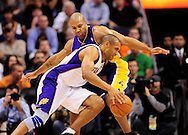 Feb. 19, 2012; Phoenix, AZ, USA; Phoenix Suns forward Granit Hill (33) is guarded by the Los Angeles Lakers guard Derek Fisher (2) at the US Airways Center. Mandatory Credit: Jennifer Stewart-US PRESSWIRE..