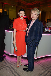NICK RHODES and NEFER SUVIO at the opening of Club To Catwalk: London Fashion In The 1980's an exhibition at The V&A Museum, London on 8th July 2013.