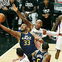 15 April 2017: Utah Jazz center Boris Diaw (33) goes for the reverse layup past LA Clippers center Marreese Speights (5) during the Utah Jazz 97-95 victory over the Los Angeles Clippers, during game 1 of the first round of the Western Conference playoffs, at the Staples Center, Los Angeles, California, USA.