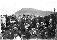 Man addressing crowd.<br />