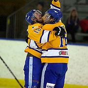 Stacey Rout (left) celebrates with team mate Mitchell Frear after scoring for Southern Stampede during the Southern Stampede V Canterbury Red Devils National Ice Hockey League matches at the Queenstown Ice Arena, Southern Stampede won both series games 5-3 and 5-2. Queenstown, South Island, New Zealand, 16th July 2011