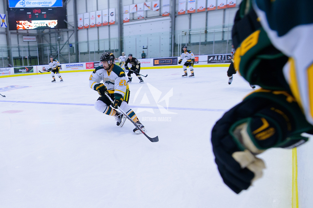 3rd year forward Colton Sparrow (22) of the Regina Cougars in action during the Men's Hockey Home Opener on October 21 at Co-operators arena. Credit: Arthur Ward/Arthur Images