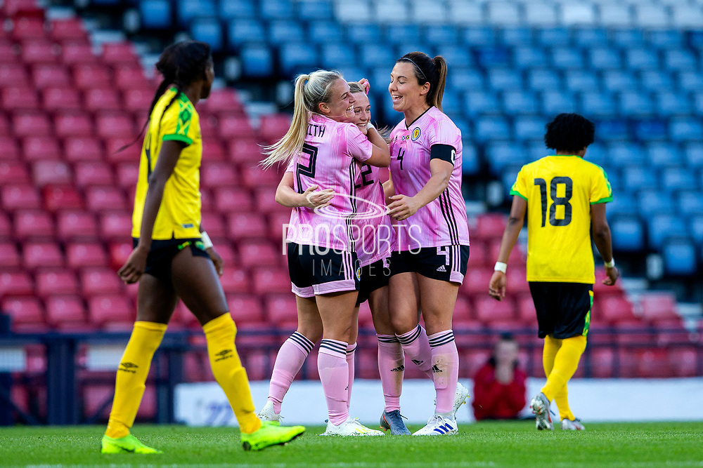 Erin Cuthbert (#22) of Scotland celebrates Scotland's first goal (1-1) with Kirsty Smith (#2) of Scotland and Rachel Corsie (#4) of Scotland during the International Friendly match between Scotland Women and Jamaica Women at Hampden Park, Glasgow, United Kingdom on 28 May 2019.