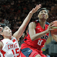 05 August 2012: USA Angel McCoughtry goes for the layup past China Nan Chen during 114-66 Team USA victory over Team China, during the women's basketball preliminary, at the Basketball Arena, in London, Great Britain.