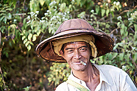 A Burmese man who had been working in the fields with his oxen pauses for portrait along the trek from Kalaw to Inle Lake in Myanmar.
