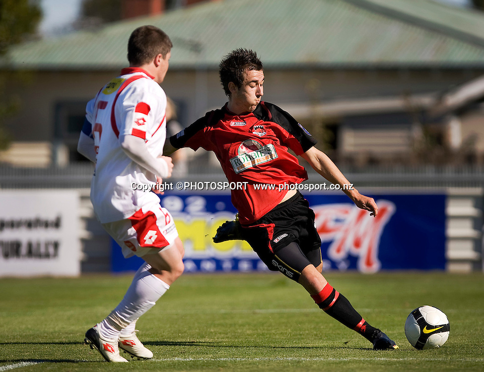 Canterbury United player Adam Smith shoots for goal with Tom Edwards in defence. Lion Foundation Youth League Final, Canterbury United v Waitakere United, English Park, Christchurch, Sunday 11 April 2010. Photo : Joseph Johnson/PHOTOSPORT