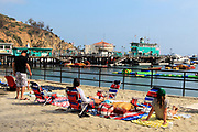 Tourists Sitting on South Beach Avalon Bay Catalina Island