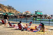 Tourists Sitting on South Beach Avalon Bay Catalina Island