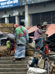 BANGLADESH DHAKA KAWRAN BAZAAR 27FEB05 - Juvenile thieves on the lookout for their next target at the Kawran Bazaar vegetable market. The Bazaar has been in the Tejgaon area for at least 30 years and is one of the largest markets in Dhaka city...jre/Photo by Jiri Rezac ..© Jiri Rezac 2005..Contact: +44 (0) 7050 110 417.Mobile:  +44 (0) 7801 337 683.Office:  +44 (0) 20 8968 9635..Email:   jiri@jirirezac.com.Web:    www.jirirezac.com..© All images Jiri Rezac 2005- All rights reserved.
