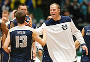Utah State center Jordan Stone celebrates with his teammates after the Aggies victory over UVU in the UCCU Center in Orem, Saturday, Dec. 15, 2012.