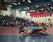 Zack Barker of Fairport competes against Hammond Raes of Midlakes in the 132-pound weight class during a match at Fairport High School on Saturday, December 13, 2014.