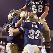 Backup quarterback Kriss Proctor celebrate with teammates after a touchdown on a brisk Saturday afternoon at Marine Corps Memorial Stadium in Annapolis Maryland...Navy improves to 7-3, Navy will return home November 20 to face Arkansas State.