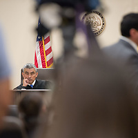 Judge James Sanchez, at left, listens to the opening statements by Assistant DA Brandon Vigil during Day 1 of the Green Case at the 13th Judicial District Courthouse in Grants Tuesday afternoon.