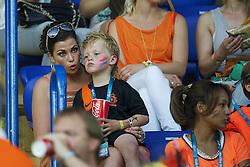 13-06-2012 VOETBAL: UEFA EURO 2012 DAY 6: POLEN OEKRAINE<br /> Gertrude Kuyt and son during the UEFA EURO 2012 group B match between Netherlands en Germany at Metalist Stadium, Charkov, UKR<br /> ***NETHERLANDS ONLY***<br /> ©2012-FotoHoogendoorn.nl
