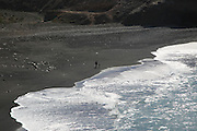 Waves breaking on black sand beach at Ajuy, Fuerteventura, Canary Islands, Spain