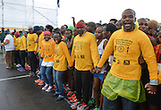 PORT ELIZABETH, SOUTH AFRICA - JULY 30: marshals keeps the athletes behind the line at the start line during the SA Half Marathon Championships on July 30, 2016 in Port Elizabeth, South Africa. (Photo by Roger Sedres/Gallo Images)