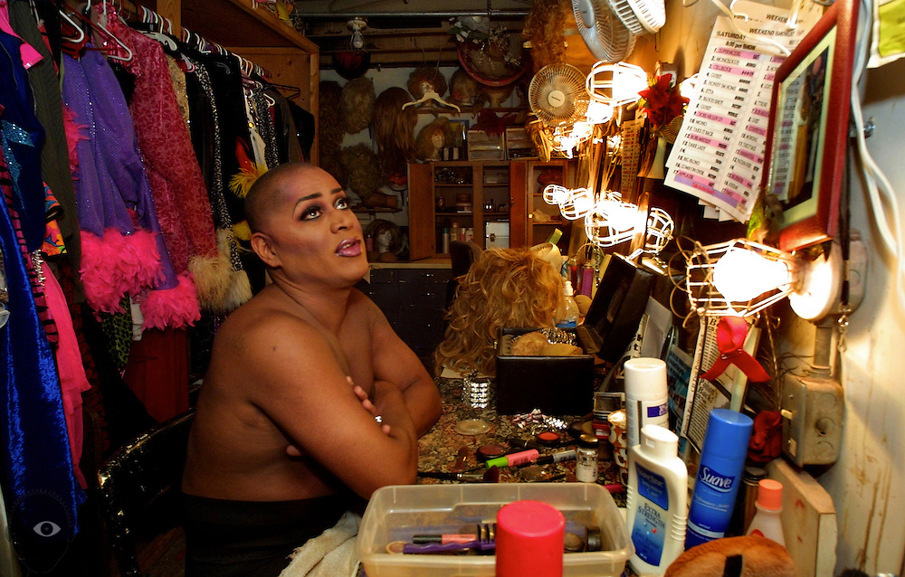 Kevin Clark (aka Poison Waters) readies himself for the next show backstage at Darcelles IV in Portland, Oregon. It is the longest running drag show in town and features many lavish costumes and over-the-top performances.