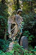 Ornamental grave statue in Highgate Cemetery London