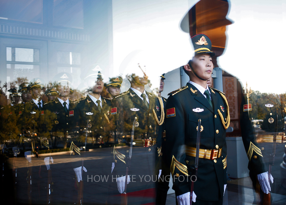 epaselect epaselect epa04474305 Chinese honor guards are seen through a glass door before a welcome ceremony for Emir of Qatar, Sheikh Tamim bin Hamad Al Thani at the Great Hall of the People in Beijing, China, 03 November 2014. Qatar's Emir is in China for a state visit from 02 to 04 November.  EPA/HOW HWEE YOUNG