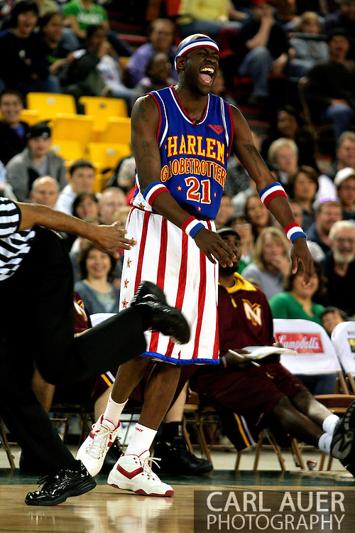 """04 May 2006: Kevin """"Special K"""" Daley (21) laughs as the referee stumbles past him during the Harlem Globetrotters vs the New York Nationals at the Sulivan Arena in Anchorage Alaska during their 80th Anniversary World Tour.  This is the first time in 10 years that the Trotters have visited Alaska."""