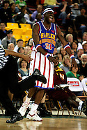 "04 May 2006: Kevin ""Special K"" Daley (21) laughs as the referee stumbles past him during the Harlem Globetrotters vs the New York Nationals at the Sulivan Arena in Anchorage Alaska during their 80th Anniversary World Tour.  This is the first time in 10 years that the Trotters have visited Alaska."